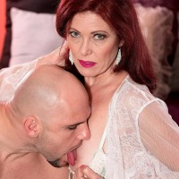 Mature lady with red hair Dana Devereaux face sits her toy guy after delivering a fellatio