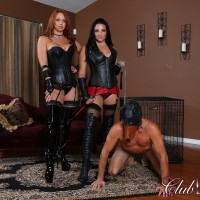 Michelle Lacy and a tempting wife dominate a hooded male in latex and lengthy boots