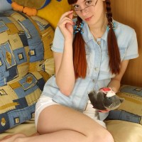 Nerdy red-haired with a great ass and bush strips off her glasses to model completely naked