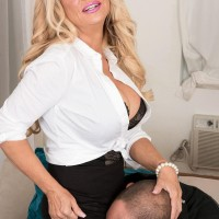 Elderly blonde manager dame Bella Dea extracting huge boobs before delivering BLOWJOB in work place