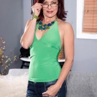 Experienced dame Dana Devereaux seducing junior stud for sex attired glasses