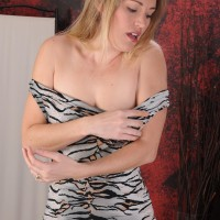 Over 30 golden-haired crosses her fine legs after removing a sundress for her first naked poses