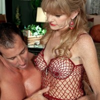Over Fifty MILF Denise Day letting gigantic tits free from lingerie for nipple eating