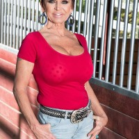 Over Sixty woman Gina Milanos tempts a young man with her big tits in denim shorts