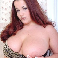 Red-haired MILF Annie Swanson wets her monster-sized titties in the bath during solo activity