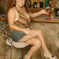 Ginger-haired babe Brandy Dean whipping out huge boobies in denim microskirt and heels