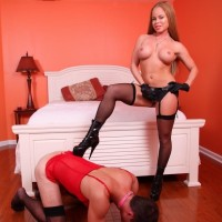 Redhead wife Nikki Delano plows her sissy guy in the butt with a strapon dick in stockings