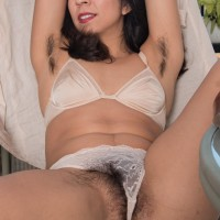 Irresistible first-timer Vivi Marie showcases off her hairy underarms and full pubic hair out on the balcony