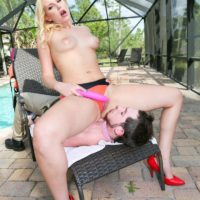 Alluring light-haired Vanessa Box faces sits the pool man while sans bra on a deck in red pumps