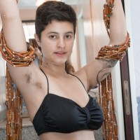 Short haired all natural first timer female Sue flaunting unshaven armpits and slit