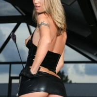 Stunner Alina Long shows her tiny titties in latex garb and hip high boots