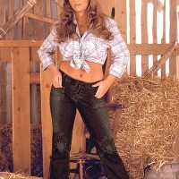 Solo chick Ines Cudna letting huge breasts loose in denim jeans and cowgirl hat in barn
