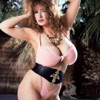 Solo adult vid starlet Jessica Fun bags bares her huge boobies from swimsuit by a swimming pool