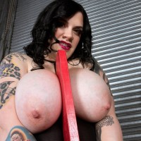 Inked BIG SEXY WOMAN Marilyn Mayson showing off giant boobies and giant ass in black boots
