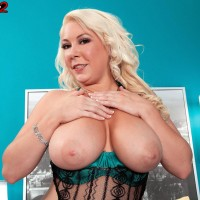 Plumper blonde solo female Morgan Page letting fun bags free from fabulous lingerie in high-heeled shoes