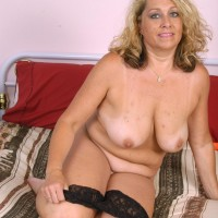 Fatty elderly fair-haired doll removing lingerie and undies before masturbating