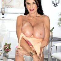 Top elder XXX adult star Rita Daniels exposes her hefty tits and flashes her panties as well