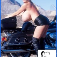 Elder model Kayla Kleevage puts her huge breasts on showcase in leather by a motorcycle