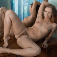 Red-haired first-timer Nikky B touts her elastic arse before parting her shaven cunt