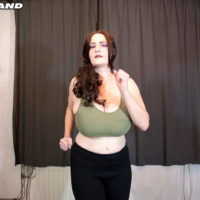 Sexy redhead solo female Cleo pulls out her big breasts during a yoga routine