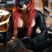 Solo model Karen Fisher pulls out her humungous boobies and butt from latex attire at Halloween