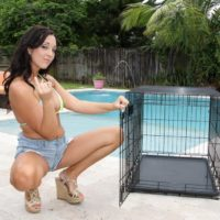 Adriana Lily lets collared submissive loose from cell outdoors by pool for pegging
