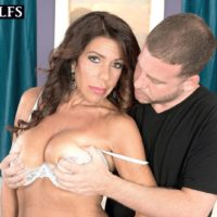 Aged black-haired doll Layla LaMora having humungous titties and booty freed from lingerie
