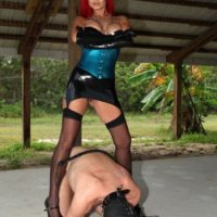 Alexia Jordon and Amadahy Mistrix are joined by a third Dom during CFNM play