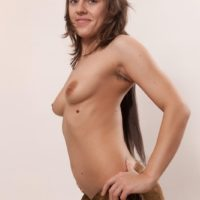 Amateur solo female Dominique exposes her natural titties before showing her unshaven cooter