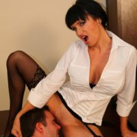 Angie Noir opens up her stocking attired pins for cooch tonguing from a sissy boi