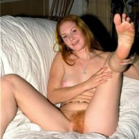 Shoeless amateur with firm titties touts her bare butt and furry honeypot in her bedroom