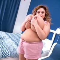 BIG HOT LADY Anna Katz tugs on her nipples after loosing her large boobs in a bedroom