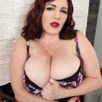 BBW Roxee Robinson uncovers her monster tits from her sundress and bra