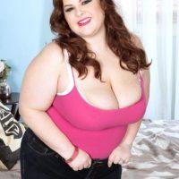 BBW solo model Jordynn LuXXX removes denim jeans before showing her immense titties