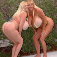 Enormous breasted blond Kayla Kleevage and a similar shaped lesbian smooch while in a pool