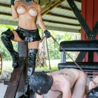 Big-titted ash-blonde Dom Alexis Fawx leads two masked male slaves on leashes