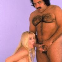 Massive titted fair-haired Kayla Kleevage gargles infamous pornstar Ron Jeremy's penis before sex