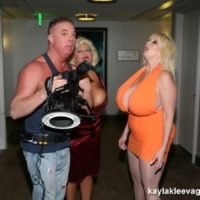 Large breasted blondes Kayla Kleevage and Claudia Marie give a dual BLOW JOB during a 3some