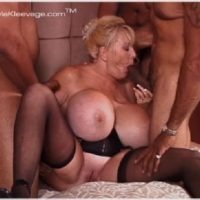 Huge breasted experienced ash-blonde Kayla Kleevage participates in an multiracial gangbang on her bed