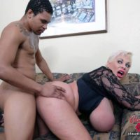 Massive breasted platinum platinum-blonde Claudia Marie takes part in interracial sex on a chesterfield