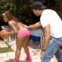 Black chick Ayana Angel flaunts her humungous butt in a short mini-skirt while dripping a basketball