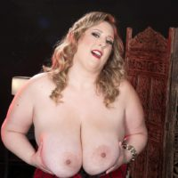 Yellow-haired BBW Amiee Roberts plays with her hefty breasts after pulling them out