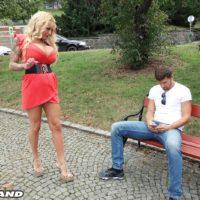 Fair-haired bombshell Bambi Blacks entices a man on a park bench in a short sundress