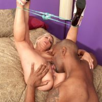 Ash-blonde granny Andi Roxxx tongue smooches a black guy before having her cooter slurped