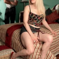 Yellow-haired granny Jennifer Janes has her boobs and cunt unveiled by her black paramour