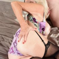Sandy-haired grandma Leah L'Amour gives her man toy a handjob in lingerie and tights