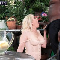 Sandy-haired granny Robin Pachino tempts a boy with a monster-sized black dick outdoors