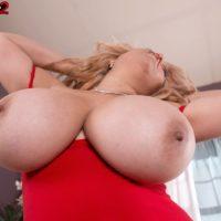 Blond Latina MILF Nancy Navarro revealing gigantic all natural boobs in pumps