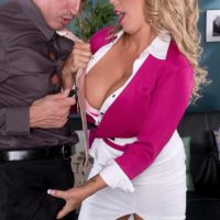 Light-haired MILF XXX pornstar Amber Lynn Bach giving titty bang after being undressed