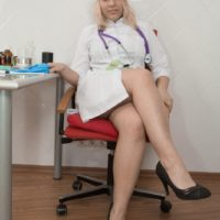 Sandy-haired nurse Jill undresses in her work environment to show her fur covered snatch in heels